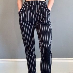 Black and white vertical stripped pants.